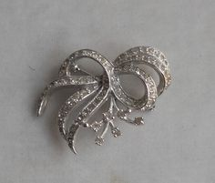 For similar items, click through to The Family Jewels Online Shop: FamilyJewelsNYC.etsy.com #Bow #Rhinestone #1950s #Abstract #Ribbon #Silver #Brooch #Pin