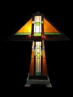 This is a beautiful Mission style stained glass lamp made with individual hand-cut pieces of glass soldered together to make this gorgeous lamp. It is hand crafted using the same rich techniq Stained Glass Lamp Shades, Stained Glass Table Lamps, Stained Glass Church, Rustic Lamps, Antique Lamps, Craftsman Furniture, Craftsman Lamps, Craftsman Farmhouse, Craftsman Houses