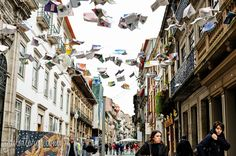 "Flying Books Over Rua Das Flores, Porto, Portugal by Gail at Large In December 2014 an art installation went up in Porto called ""Livros Voadores"" or ""Flying Books"" that suspends lines of books over Rua das Flores, and I was curious about the logistics of this until to..."