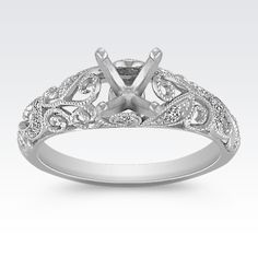 This intriguing vintage inspired engagement ring holds 16 round pavé-set diamonds, at approximately .09 carat total weight. Crafted in quality 14 karat white gold, the intricate milgrain and engraved detailing are simply breathtaking. Add the center stone of your choice to complete this eye-catching look.