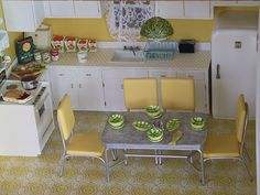 I don't know where to put this, I just think it's so cute.  1950s kitchen...yellow dining table and chairs