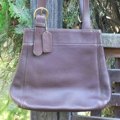 """🍀VINTAGE 90's Coach Brown Leather Waverly Tote Coach buckle bag in buttery soft brown leather. Dual handle tote shopper in EXCELLENT condition. Very slight normal wear shown. Main compartment has magnetic snap closure, one inside zipper pocket. Includes original hangtag.  Creed No. L6C-4157  Height : 9"""" Depth : 5"""" Width : 8"""" Strap length : 30.5""""; adjustable from 26""""-28"""" Strap drop : 13""""-14""""  See separate listing for additional photos. (75/60/54) GR2 Coach Bags Totes"""