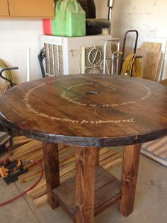 This was originally a 4 foot cable reel dismantled and built to create a pub size table. A bible verse was handpainted for a family in memory of their 8 year old son who passed away. Wooden Spool Projects, Wooden Spool Tables, Cable Spool Tables, Wooden Cable Spools, Old Wood Table, Pallet Furniture, Furniture Projects, Repurposed Furniture, Cable Reel Table