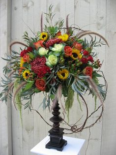 Fall Centerpiece Wedding --lose the feathers, they detract.  Also seems a bit top heavy and tippy.