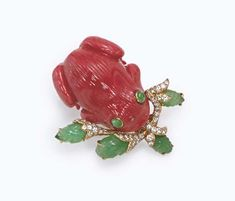 A CORAL, EMERALD AND DIAMOND BROOCH, BY DAVID WEBB