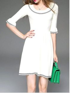 StyleWe White with black piping sweater dress and green purse. Great women's fashion outfit perfect for your engagement photo shoot