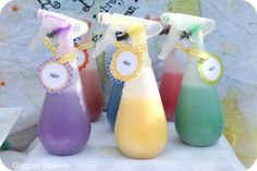 Love the paint in the spray bottles! Perfect for all the guests to use to paint a plain white sheet hanging up!