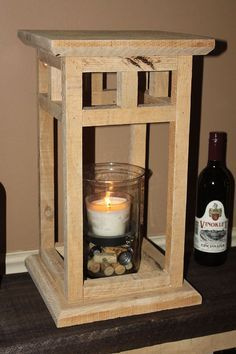 How to make a rustic lantern from repurposed pallets--very cute for a holiday mantle!