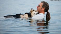 "John Unger and his dog Schoep in Lake Superior.  The only relief his dog had from severe arthritis was being suspended in water.  Schoep would fall asleep as his owner gently gave him aquatic therapy. This photo generated so much financial support the owner was able to create a foundation called ""Schoep's Legacy"" which provides assistance to dogs in need!  There is still goodness in the world!  My heart is melting with pure joy!  Story at link."