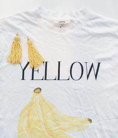 Yellow tassel earrings and Ganni shirt