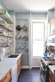 Notice how tile stops before ceiling.  Small Galley Kitchen Ideas