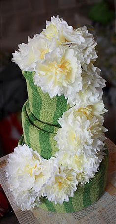 Bridal Shower Centerpiece --towel cake decorated with coffee filter flowers.