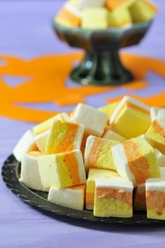 These DIY Candy Corn Marshmallows are so cute! You can't go wrong when you cross a Halloween candy with marshmallows. This makes for a great Halloween dessert recipe.