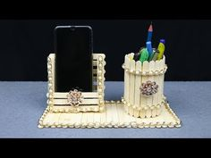 Homemade Pen stand and Mobile phone holder with ice cream sticks Pop Stick Craft, Ice Cream Stick Craft, Diy Popsicle Stick Crafts, Stick Art, Craft Sticks, Creative Crafts, Diy And Crafts, Crafts For Kids, Unique Christmas Ornaments