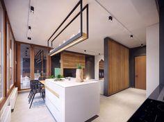 Ilot central de cuisine de toute élégance dans l'intérieur design de cet appartement moderne