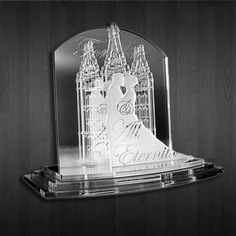 """laser engraved cake topper made of 100% mirrored, frosted, and clear acrylic featuring an LDS Temple, a couple getting married, and the words """"For Time And All Eternity"""""""