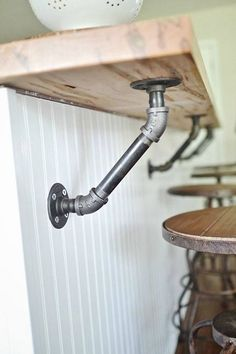 Use industrial pipes to hold up a wood bar! More