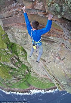 Don't look down: While most people would be terrified at the sheer drop beneath them, Dave MacLeod is happy to take a break, and enjoy the views