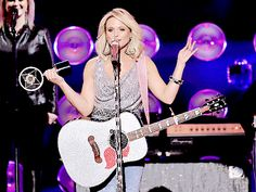 I absolutely love her guitar!!