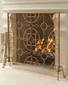 """Equestrian"" Fireplace Screen - Horchow Yes...but not in gold. Would have to be refinished in nickel/silver tones."