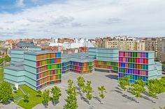 For MUSAC—a contemporary art museum in León, Spain—architecture firm Mansilla+Tuñón was inspired by the stained glass in the city's Gothic architecture. In their contemporary homage, the architects used colored glass panels to create the building's joyous exterior.