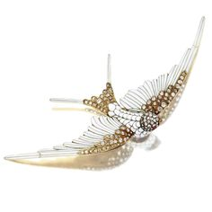 DIAMOND AND ENAMEL SWALLOW BROOCH/HAIR ORNAMENT COMBINATION, CIRCA 1890 Rose-cut and old mine diamonds weighing approximately 1.00 carats, applied with white enamel, mounted in 18 karat gold