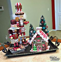 Home Decor tray holds a gingerbread house, nutcrackers and miniature Christmas tree