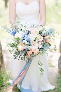 Cornflower Blue and Peach Wedding Color Ideas: White bride, Cornflower bridesmaid dresses, peach and blue wedding bouquets, Black groom and groomsmen suits, neutral table linens with peach and blue wedding centerpieces… Peach Wedding Colors, Blue Purple Wedding, Blue Wedding Flowers, Floral Wedding, Pink Blue, Trendy Wedding, Dusty Blue, Summer Wedding, Wedding Bride