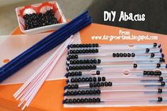 Classroom DIY: Make an abacus with kiddos to teach number sense and then use it to manipulate numbers. Beads on pipe cleaners is one of my favorite fine motor activities - there is something about the fuzz and the bead that most kiddos find irresistible.  This uses pipe cleaners and drink stirrers, that would be even cooler