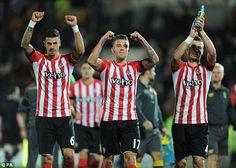 Jose Fonte (left) celebrates a win over Hull with Toby Alderweireld (centre) and Morgan Sc...