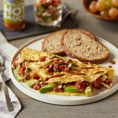 California-Style Omelets : A  breakfast favorite with Hunt's® Organic Tomatoes, baby spinach, feta cheese and Frontera® Creamy Salsa Verde