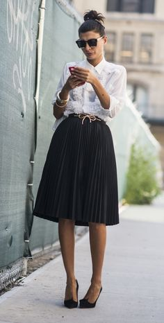 A pleated skirt and a button-down shirt
