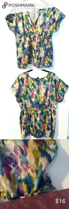 """Lane Bryant 22/24W Watercolors Surplice Top This Lane Bryant 22/24W Watercolors Surplice Top is in good used condition. It has a surplice (faux wrap) front with a smocked stretchy waistband. Bust measures 25"""" across laying flat, measured from pit to pit, so 50"""" around. Fabric has no stretch, 100% polyester, colors include gray, turquoise, puple, & chartreuse green. 31.5"""" long. ::: Bundle 3+ items from my closet and save 30% off when you use the app's Bundle feature! ::: No trades. Lane…"""