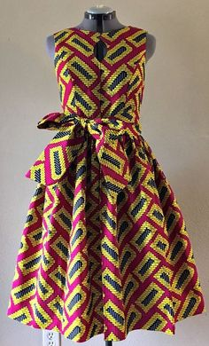 african fashion ankara Quirky Fall Dress African Wax Print Keyhole Bodice Fit and Flare Cotton Hot Pink Yellow Black Geometric Print With Pockets and Belt. African Fashion Ankara, Ghanaian Fashion, African Inspired Fashion, Latest African Fashion Dresses, African Print Fashion, Africa Fashion, Nigerian Fashion, African Style, Short African Dresses