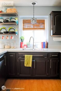 Inexpensively update your counters with paint... and get a super glossy finish you'll love!