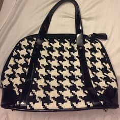 Black and white purse Black/White Purse with cute tassel zippers. Cloth fabric similar to a tweed. Brand is Fog designs. Brand new never used. Perfect condition. Bags Satchels