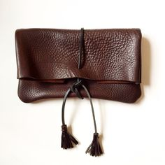 Chocolate leather clutch, hand made leather tassels, a beauty!
