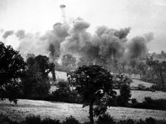 Thousand pound bombs explode near German lines during tha launch of a new American offensive in the Saint-Lô sector, july 26, 1944. This was the last picture taken by Associated Press war photographer, G. Bede Irvin, before he was killed by a bomb fragment. The film pack containing this picture was the only part of Irvin's equipment left intact by the bomb explosion and was sent from the front by a fellow photographer.