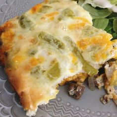Chile Rellenos Casserole 1/2 lb. beef 1/4 onion (chopped) 1 10 oz. can whole green chilies 1 1/2 cups cheddar cheese 2 eggs 3/4 cups milk 1/8 cup flour 1 tsp cumin 1/2 tsp salt 1/2 tsp pepper