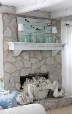 Looking to paint your stone fireplace? Check out this stone fireplace painting guide for tips and techniques on how to pull of your own stone fireplace painting makeover. Painted Stone Fireplace, Stone Fireplace Makeover, Paint Fireplace, Home Fireplace, Fireplace Remodel, Living Room With Fireplace, Fireplace Design, My Living Room, Fireplace Makeovers