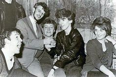 """A new book of personal photographs from Ringo Starr—titled """"Photograph""""—offers a behind-the-scenes look at life as a member of The Beatles, and includes many never-before-seen images. Here is Paul McCartney, Starr and George Harrison with friends in 1961. Photos by Ringo Starr/Genesis Publications"""