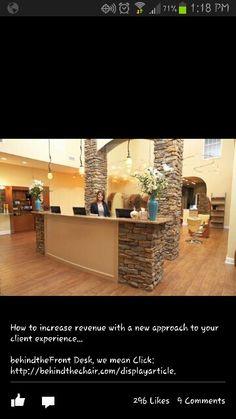 Salon love the reception desk with the rock!