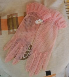 Unworn 1950s Sheer Pink Perlon Nylon Net Gloves NWT Ruffle at Wrist Rockabilly Pinup sz 7 by ExpatriateVintage on Etsy https://www.etsy.com/listing/221823697/unworn-1950s-sheer-pink-perlon-nylon-net