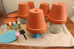 How To Seal Painted Flower Pots - Turn pots upside down on stands to paint all surfaces at once