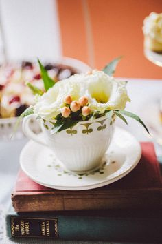 flowers in teacups - Read more on One Fab Day: http://onefabday.com/blackwater-castle-wedding-by-white-cat-studio/ flowers by wild.ie