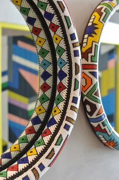 Locally designed mirror hangs proudly on display, Nandos South Africa South African Decor, South African Design, African Home Decor, African Room, Beaded Mirror, African Crafts, African Accessories, Africa Art, African Textiles