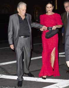 Reaching for her hand: Catherine teamed her dress, that had a thigh-high split, with a black Chanel belt while Michael looked sharp in a grey silk suit and a black shirt. Silk Suit, 75th Birthday, Catherine Zeta Jones, Mature Fashion, Thigh Highs, Thighs, Mature Style, Dress Shoes, Shoes Heels