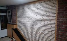 Latte brick tiles for this restaurant feature wall