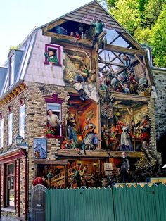 AMAZING BUILDING PAINTED MURAL - HISTORY! http://en.wikipedia.org/wiki/Petit_Champlain Petit Champlain is a neighbourhood in Quebec City, Canada. It is located in the district of Vieux-Québec–Cap-Blanc–colline Parlementaire in the borough of La Cité-Limoilou, near Place Royale. Its main street is the Rue du Petit-Champlain at the foot of Cap Diamant. It is the oldest commercial district in North America.[1]