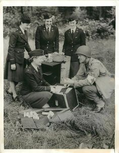 U.S. Army nurses training for front line work in Britain. Here the nurses are looking at the contents of a field medical chest at their training center, 1943 ~